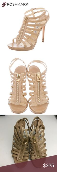 "Jimmy Choo Leather Cage Sandals Tan leather Jimmy Choo platform sandals with tonal stitching, covered heels and gold-tone zip closures at uppers. Designer Fit: This designer runs a half size small. Platforms: 0.5"" Heels: 5.5"" Item#: JIM65814                                                    Good condition. No tarnishing on zipper or zipper pull heels are worn once. General moderate scuffs as shown in pics 6-8, won't be noticed when worn. Pics 1-2 stock photos, other pics of actual item…"