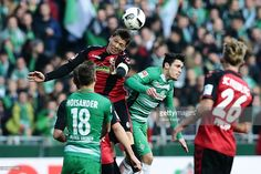 Zlatko Junuzovic (R) of Bremen and Mike Frantz (L) of Freiburg compete for the ball during the Bundesliga match between Werder Bremen and SC Freiburg at Weserstadion on October 29, 2016 in Bremen, Germany.