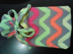 DIY hot water bottle cover. Keeps your hot water bottle hotter for longer and also makes it look stylish (: