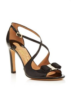 Signature grosgrain bows add an element of iconic Italian style to these strappy Salvatore Ferragamo sandals. | Patent leather upper, patent leather and leather lining, leather sole | Made in Italy |