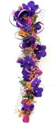 Wicked wire and orchid cascade bouquet!  #purple #orange #TangerineTango