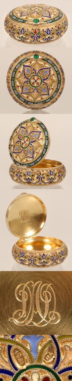 A Russian gilded silver and cloisonne enamel circular box, 11th Artel, Moscow, circa 1908-1917. The box with hinged lid is decorated in a multi-color scroll and geometric design against a gilded stippled ground.