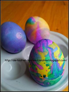 Dying Easter eggs with liquid watercolor and droppers. Great for young toddlers and developing fine motor skills.