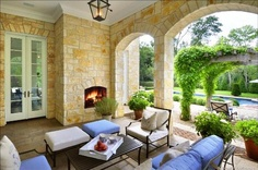 Lovely covered patio and stone work.  I love the pop of blue complimenting the pool.