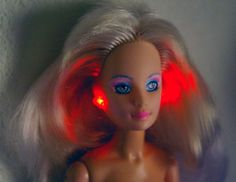 Jem Barbie doll- I had.  My sister had the Misfit one with green hair