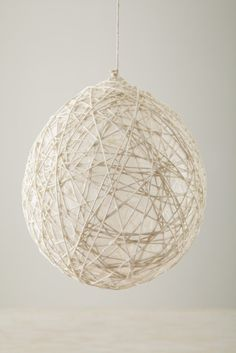 Hanging String Balls. Like the Easter Egg craft on Pintrest but you can use it in your house as a year round decoration.