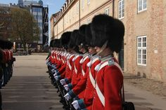 Livgarden - The Danish Royal Guard in dress uniform - must be a royal birthday or royal celebration or something like that else their uniform is blue...