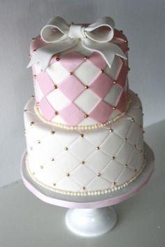 Pink and white wedding cake with gold beads and a white bow on top #wedding #weddingcake #cake #white #pink