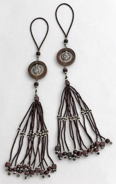 Leopard-print orbs encompassed by wooden are the focal point for this unique pair of beaded tassels. Please visit my Etsy Shop www.gmbdesignscustom.etsy.com