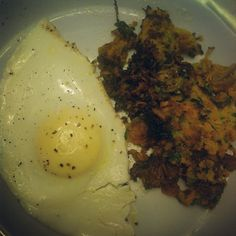 """Sweet potato zucchini hash with an over medium egg. Ugly photo beautiful flavor #cookingwithkat #eatclean"""
