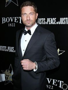 Gerard Butler rocks the tux at the Pre-Oscar Hollywood Dominos GALA