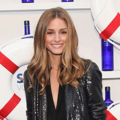 You're ticket to summer-dinner-date-night cuteness? Brown eyeliner and a shimmery peach eyeshadow, as seen here on Olivia Palermo.