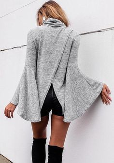Put on a super fab winter outfit with this grey bell-sleeved back-slit top.