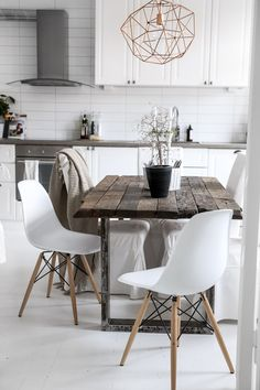 Love the rustic industrial table in the modern design