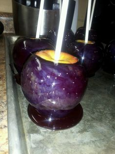 Purple Cosmos Candied Apples!  Melt Joly Ranchers in a double boiler and add edible glittler, then dip each apple and let cool. You can also use food coloring with caramel and edible glitter if you don't want to make candied apples.