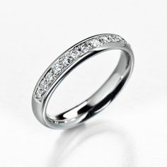 White gold half eternity ring. Round and smooth comfort fit.