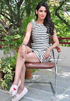 Sonal Chauhan Showing Her Milky Thighs In a Black & White Striped Mini Skirt....