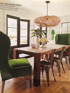 Large green velvet wingback + wood + metal tub chairs