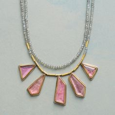 ANGEL WINGS NECKLACE--Grace and grandeur meet as pink tourmaline emerge from glowing 22kt gold surrounds