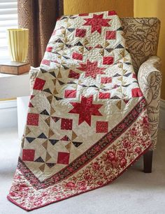 Stars and Pinwheels combine to make this full-size bed quilt. The triangle-squares 8 at a time technique is used to make this quilt.