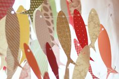 paper fish strung in lines - artist Ana Joao , Portugal.