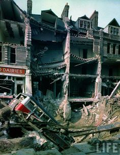 1940 London at War - London Bus 1940 - Wreckage of bus leaning into huge crater in front of bombed out buildings, a result of German aerial blitz attacks during the Battle of Britain. WWII (V) London History, British History, World History, World War Ii, Vintage London, Old London, London Bus, Blitz London, London Street