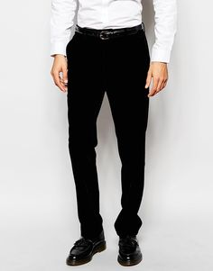 "Trousers by ASOS Soft-touch velvet Fully lined Zip fly with hook, bar and button fastening Side pockets and two back pockets Slim fit - cut closely to the body Dry clean 100% Polyester Our model wears a 32""/81 cm regular and is 191cm/6'3"" tall"