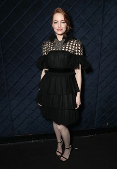 Emma Stone Little Black Dress - Emma Stone looked darling at the AACTA International Awards in a Gucci LBD featuring a tiered skirt, a mesh yoke, and a crystal bow.
