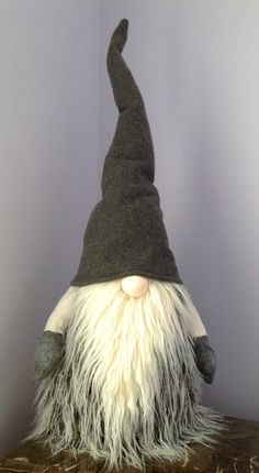 This Huggable Tomte Gnome stands approx. 29 Tall! He is approx. 11W This adorable handmade gnome will make a great addition to your home! Whether for the Holidays or everyday decor, this guy is sure to bring a smile to your face. He features a weighted bottom for extra standing ability and a bendable hat and arms to position anyway you desire! All fur used is faux fur (fake fur) He has a solid grey fleece hat and gloves to keep warm! Measurements of height are taken from top of hat down to…