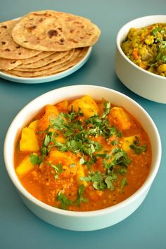 batata rassa is a gujarati curry garnished with coriander and served with indian bread