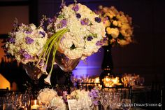 white and purple centerpieces
