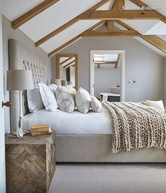 Modern farmhouse. In a warm neutral scheme like this, it's all about the textures. Think about layering the bed with crisp cotton sheets, a pure linen duvet cover and a chunky knitted throw. Soft carpeting, or wood floors with a cozy area rug, feels delightful on chilly mornings. Keep the space calm and natural with a neutral paint color like warm gray or flax and white trim.