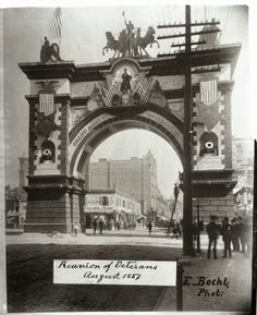 Arch at Olive Street and Twelfth Street (looking east on Olive) erected for the Grand Army of the Republic reunion, August 1887. Missouri History Museum