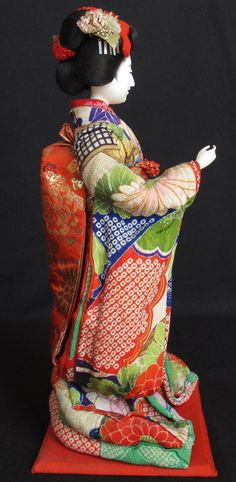 """Antique Japanese Meiji Costume Doll Maiko Isho Ningyo With BOX   eBay She is mounted on the wooden board on the bottom and it comes in an original wooden box which has a writing """" Akairi Moyo Maiko """"."""