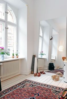great rug on white floors