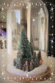 Christmas cloche by @amandineassmat who use her Lemax figurines and trees to create a wonderful christmas dispay. Follow us on our christmas blog audreychristmascarol.blogspot.fr #christmas #lemax #cloche