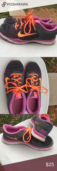 Nike tennis shoes Comfortable Nike tennis shoes! Cute colors, pink and bright orange, barely worn Nike Shoes Athletic Shoes