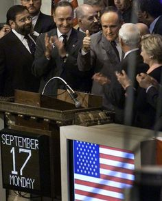 """NYSE opens again  New York City Mayor Rudolph Giuliani, center, gives a thumbs up to traders on the floor Monday, Sept. 17, 2001. """"God Bless America"""" was sung before Giuliani helped ring the opening bell of the New York Stock Exchange for the first time since the Sept. 11 terrorist attack on the World Trade Center."""