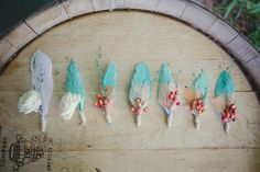 Boho feather boutonnieres. Photography by closertolovephotography.com  Read more - http://www.stylemepretty.com/2013/08/15/southern-california-wedding-from-closer-to-love-photography/