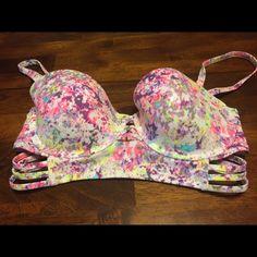 Victoria Secret swimsuit top Victoria swimsuit top size 34D, it has never been worn to small for me! Victoria's Secret Swim Bikinis