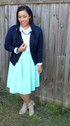 navy blue and mint pleated skirt modest outfit idea for fall with taupe boots