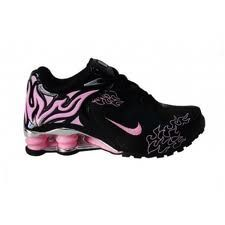 Pink and black sneakers ready to bounce to the moon...