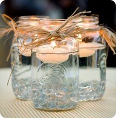 Another way to do the candles mason jars filled with water/floating candle and raffia tied around the top in the bottom are clear marbles