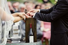 During their ceremony, this couple sealed a special bottle of wine in a wooden box to save and drink on their first anniversary ~ every anniversary after that they will save a new bottle to drink the next year! What a unique idea! #wine #wedding