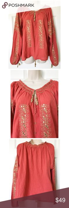 """SOLD! This is a gorgeous peasant top from Melissa Odabash!  The color is terracotta and it features soft gold tassel pulls, embroidery and sequins.  It is made of 100% cotton, it is One Size, and the bust measures approximately 50"""".  This top is in nearly new condition!  The only flaw I see is a small slightly faded spot to the left of the buttons ~ please see the last photo.  It is super hard to notice and I never did until I took these photos.  It's a gorgeous top! Melissa Odabash Tops…"""