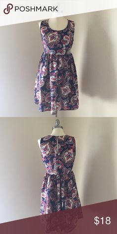 """Paisley and print dress Fit and flare dress with pink paisley print on navy. Pull over styling with tie back to define the waist. Length = ~33"""" / waist = ~34"""" Band of Gypsies Dresses"""