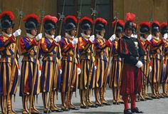 """Corps of Swiss soldiers responsible for the safety of the pope. Often called """"the world's smallest army,"""" they serve as personal escorts to the pontiff and as watchmen for Vatican..."""