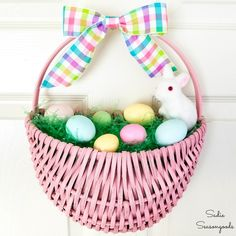 A flat back basket or hanging door basket is upcycled into Easter door decorations with this upcycling idea! Filled with Easter grass and colorful eggs, this Easter wreath is about as cute as it gets and perfect for Easter decoration ideas! Easter Bunny Decorations, Easter Wreaths, Easter Centerpiece, Halloween Decorations, Foam Crafts, Decor Crafts, Home Decor, Diy Crafts, Craft Foam