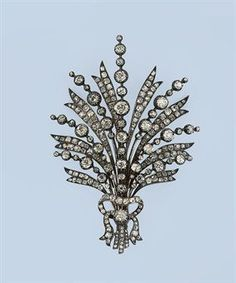 AN ANTIQUE DIAMOND AIGRETTE  Designed as a spray mounted throughout with cushion-shaped diamonds to a similarly-set ribbon base, 19th Century.