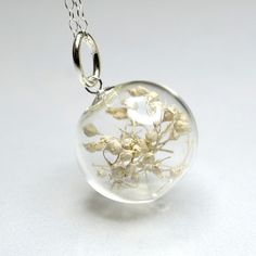 White dried babys breath flower blown glass ball silver necklace
